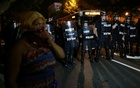 A demonstrator is greeted by police in riot gear while continuing to protest after curfew in Charlotte, North Carolina, US, September 25, 2016. REUTERS/Mike Blake