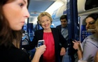 US Democratic presidential candidate Hillary Clinton talks to reporters on her campaign plane in White Plains, New York, United States September 27, 2016. Reuters
