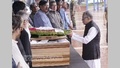 President Md Abdul Hamid pays last respect to prolific writer Syed Shamsul Haq by placing wreath at his coffin at the Central Shaheed Minar in Dhaka on Wednesday.