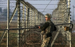 This Reuters file photo shows an Indian Army soldier on guard along the border with Pakistan.