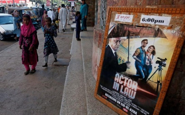 An advertising poster for an Indian film is seen outside a movie theatre in Karachi, Pakistan, Sept 30, 2016. Reuters