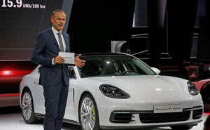 Porsche CEO Oliver Blume speaks near a Porsche Panamera 4 E-Hybrid during a news conference on media day at the Mondial de l'Automobile, the Paris auto show, in Paris, France, September 29, 2016. Reuters