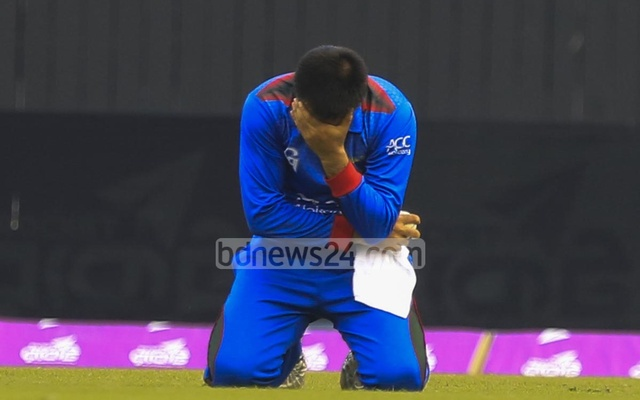 Afghanistan captain Asghar Stanikzai is disappointed after dropping Tamim Iqbal on 1 in the third over of the match. Later Tamim scored a run-a-ball 118. Photo: muhammad mostafigur rahman