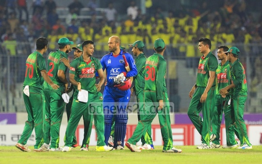 Bangladesh players exchange best wishes with Afghanistan batsman Mirwais Ashraf at the end of the match. Photo: Mostafigur Rahman