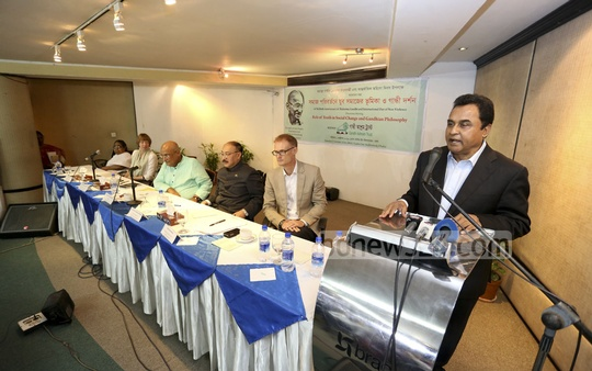 Planning Minister AHM Mustafa Kamal speaks at a discussion on the Role of Youth in Social Changes and Gandhian Philosophy at BRAC Centre Inn on Saturday.