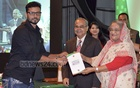 After inauguration, the players of the national cricket team were the first citizens to receive the NID cards with biometric details from Prime Minister Sheikh Hasina on Sunday. In this photo, she is handing the 'smartcard' to limited-overs captain Mashrafe Bin Mortaza.