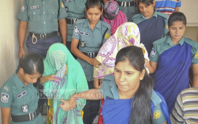 Abedatul Fatema among other militant suspects being brought out after an enti-terror raid in Azimpur.