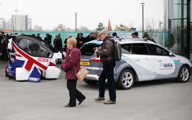 People view prototypes of a driverless vehicles in Greenwich, east London, February 11, 2015. Reuters