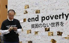 World Bank Group President Jim Yong Kim preparing to post a message about ending poverty at the venue of the lender's annual meetings in Tokyo on Oct 12, 2012. Reuters