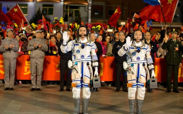 Astronauts Jing Haipeng (right), Chen Dong before the launch. Reuters