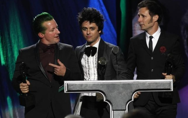 Members of the band Green Day react as they are inducted during the 2015 Rock and Roll Hall of Fame Induction Ceremony in Cleveland, Ohio April 18, 2015. Reuters