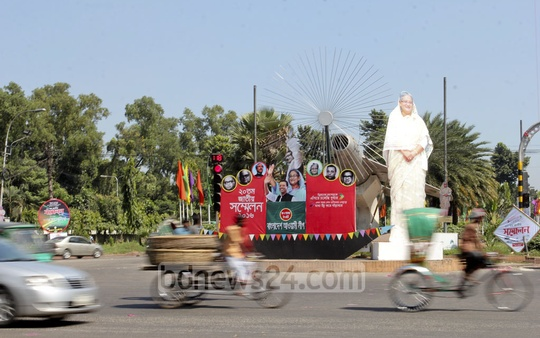 Several areas in the capital have been decorated with images of Bangabandghu SHeikh Mujibur Rahman, Prime MInister Sheikh Hasina, her son Sajeeb Wazed Joy and the four national leaders ahead of Awami League's National Council. This photo taken on Thursday shows a large cardboard cutout of Hasina's image at Bijoy Sarani. Photo: asif mahmud ove
