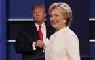Republican US presidential nominee Donald Trump and Democratic US presidential nominee Hillary Clinton finish their third and final 2016 presidential campaign debate at UNLV in Las Vegas, Nevada, US, Oct 19, 2016. Reuters