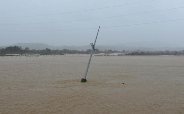 A utility pole is partially submerged in a river after Typhoon Haima struck San Nicolas, Ilocos Norte in northern Philippines, October 20, 2016. Reuters