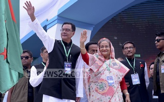 Awami League President Sheikh Hasina and General Secretary Syed Ashraful Islam wave to leaders and activists as Presidium Member Obaidul Quader gives them a sidelong glance during the National Council in Dhaka's Suhrawardy Udyan on Saturday. Photo: Saiful Islam Kallol