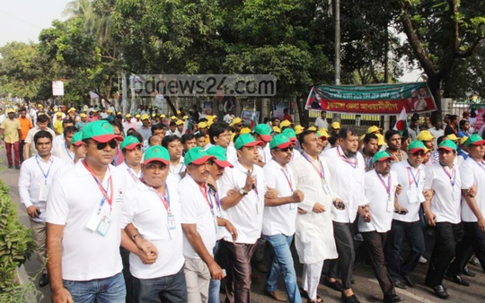 Activists march near the venue of the Awami League's 20th National Council.
