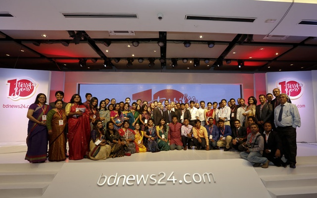 Members of the bdnews24.com family pose for a group photo during the 10th anniversary celebrations at Radisson Blu hotel in Dhaka on Sunday.