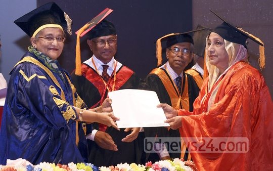 Prime Minister Sheikh Hasina hands over certificates and gold medals to degree awardees at the 13th Convocation of Bangladesh College of Physicians and Surgeons in Dhaka on Wednesday. Photo: Saiful Islam Kallol