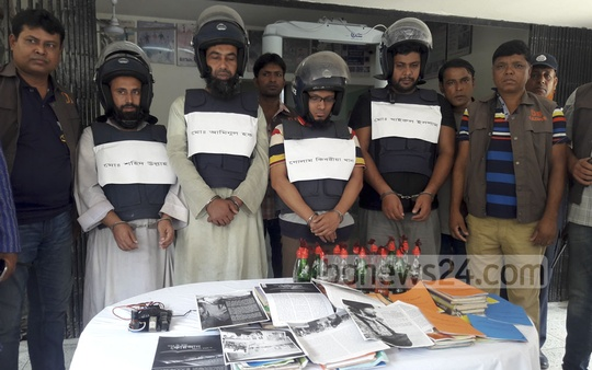 Police arrested four suspected members of banned militant outfit Harkat-ul-Jihad al-Islami (HuJI) with bombs and 'extremist' books from Gazipur on Friday night. The four were produced before the media on Friday.