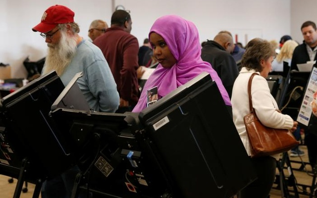 Voters cast ballots during early voting at the Franklin County Board of Elections in Columbus, Ohio October 28, 2016. Reuters