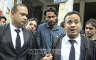 National cricketer Shahadat Hossain is seen outside a Dhaka court on Sunday after he and his wife were acquitted of charges of torturing an 11-year-old house help.
