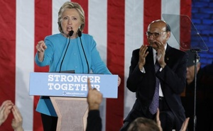 US Democratic presidential nominee Hillary Clinton speaks in front of Gold Star Father Khizr Khan at a campaign rally in Manchester, New Hampshire, US, Nov 6, 2016. Reuters