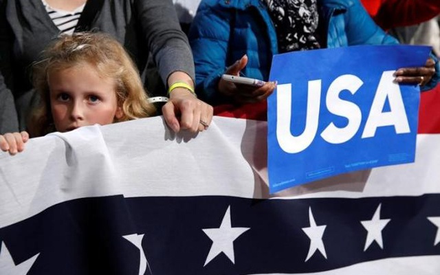 A young girl listens as US President Barack Obama campaigns for Democratic presidential nominee Hillary Clinton at the University of New Hampshire in Durham, New Hampshire, US, Nov 7, 2016. Reuters.
