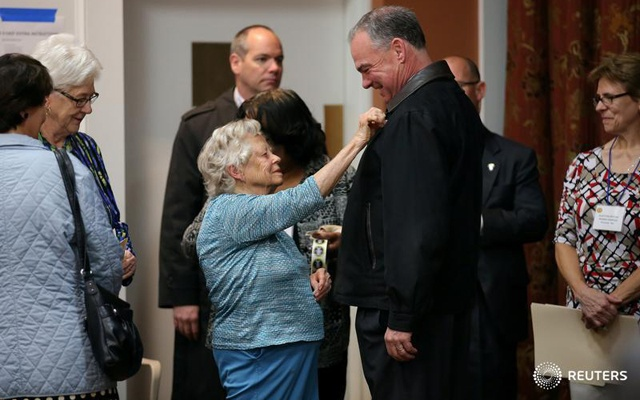 Democratic US vice presidential candidate Senator Tim Kaine gets an 'I voted' sticker after casting his ballot at the Hermitage Methodist Home polling station in Richmond, Virginia.