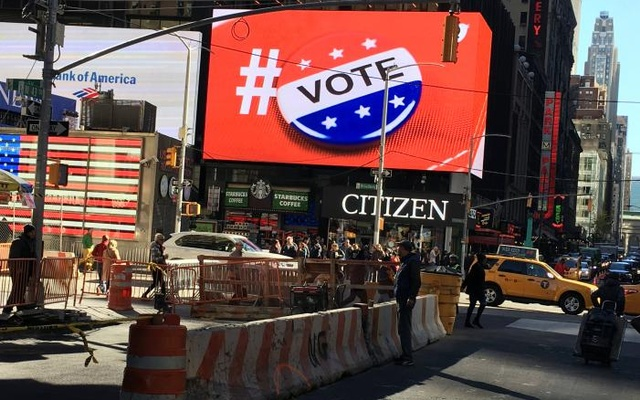 An electronic billboard displays a vote hashtag at Times Square in New York. Reuters