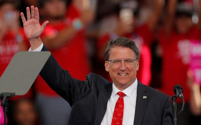 North Carolina Governor Pat McCrory waves before speaking ahead of Republican presidential nominee Donald Trump at a campaign rally in Raleigh, North Carolina Nov 7, 2016. Reuters.