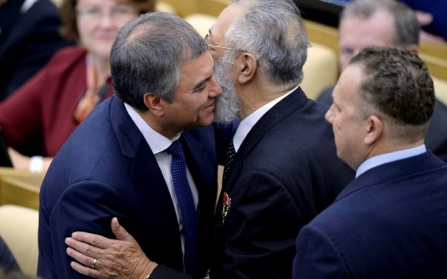 Russian member of parliament and former deputy head of the presidential administration Vyacheslav Volodin (L) embraces his colleague Artur Chilingarov during the opening session of the newly-elected State Duma, the lower house of parliament, in Moscow, Russia, Oct 5,... Reuters