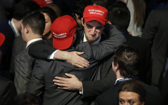 Trump supporters embrace as they watch election returns come in at Donald Trump's election night rally in Manhattan.reuters