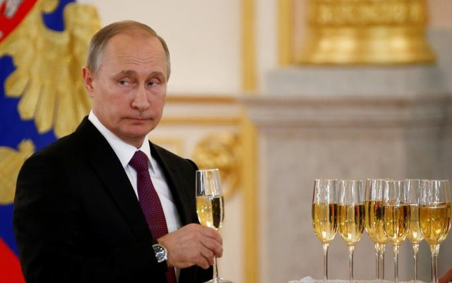Russia's President Vladimir Putin holds a glass during a ceremony of receiving diplomatic credentials from foreign ambassadors at the Kremlin in Moscow, Russia, Nov 9, 2016. Reuters