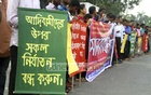Santal Students' Union demonstrate in front of the National Press Club on Friday in protest against the recent attacks and killings of the people of the tribe at Gobindaganj in Gaibandha during eviction from an acquired land. Photo: abdul mannan