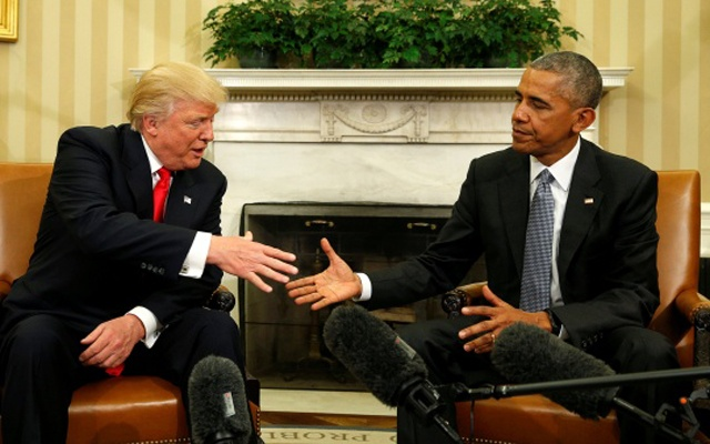 US President Barack Obama greets President-elect Donald Trump in the White House Oval Office in Washington, US, Nov 10, 2016. Reuters
