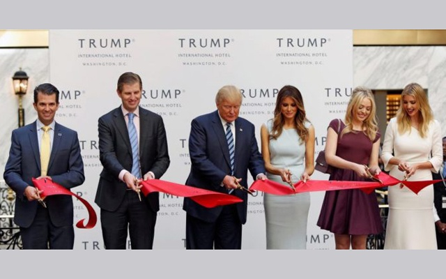 (L-R) Donald Trump Jr, Eric Trump, Republican US presidential nominee Donald Trump, Melania Trump, Tiffany Trump and Ivanka Trump attend an official ribbon cutting ceremony at the new Trump International Hotel in Washington, DC, on Oct 26, 2016. Reuters