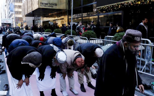 Muslims pray as they take part in a protest against presidential candidate Donald Trump outside of his office in Manhattan, Dec 20, 2015. Reuters
