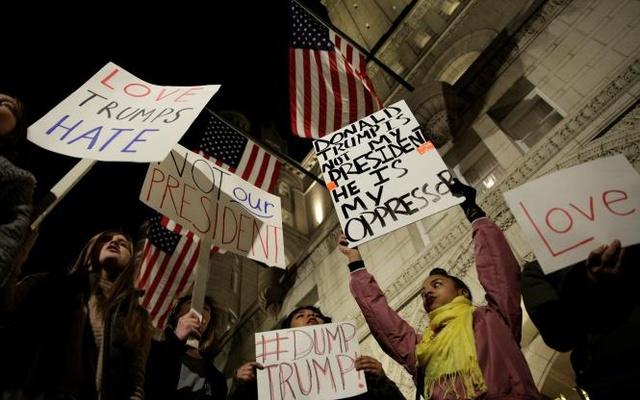 Demonstrators protest against US President-elect Donald Trump in front of the Trump International Hotel in Washington, US, Nov 10, 2016. Reuters