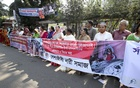 Several organisations staged a human-chain demonstration in front of the National Press Club in Dhaka on Monday against the recent attacks on Hindus and Santals.
