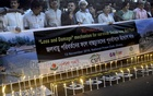 Candles are lit in front of the National Press Club in Dhaka on Tuesday to commemorate those who lost their lives when Cyclone Sidr hit the coastal region nine years ago.