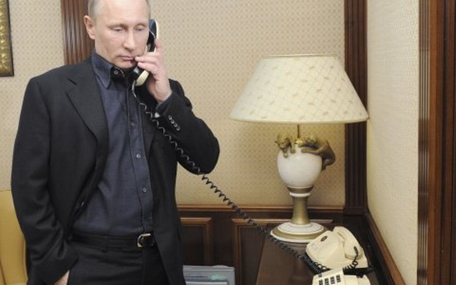 Vladimir Putin speaks on the phone at his campaign headquarters in Moscow March 4, 2012. Reuters