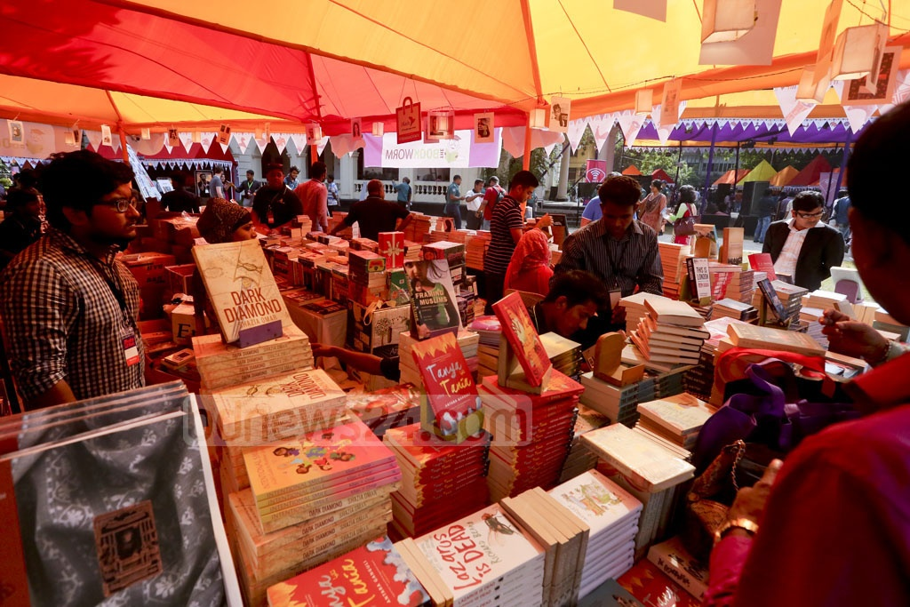 Literature buffs checking out stalls on the first day of the Dhaka LiT Fest being held at the Bangla Academy premises. Photo: asaduzzaman pramanik