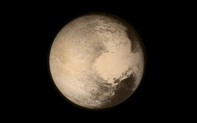 Pluto nearly fills the frame in this image from the Long Range Reconnaissance Imager (LORRI) aboard NASA's New Horizons spacecraft, taken on Jul 13, 2015 when the spacecraft was 768,000 kilometers from the surface. Reuters