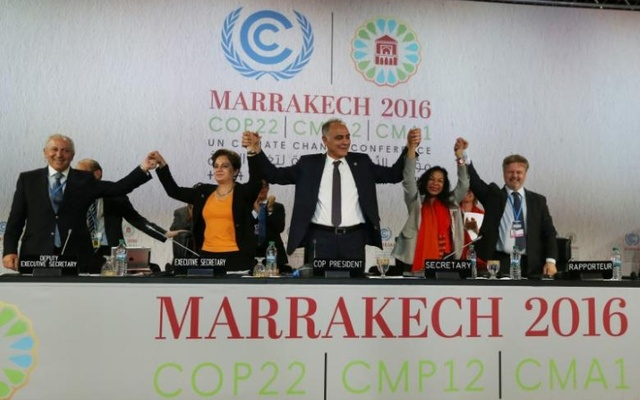 UN climate chief Patricia Espinosa (second from left), Morocco's Foreign Minister Salaheddine Mezouar (centre), and Council of Europe Goodwill Ambassador Bianca Jagger (second from right) celebrate after the proclamation of Marrakech, at the UN World Climate Change Conference 2016 (COP22) in Marrakech, Morocco. Reuters.