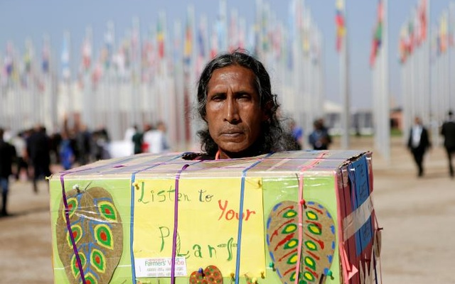 An indigenous man protests outside the UN Climate Change Conference 2016 (COP22) in Marrakech, Morocco, Nov 18, 2016. Reuters