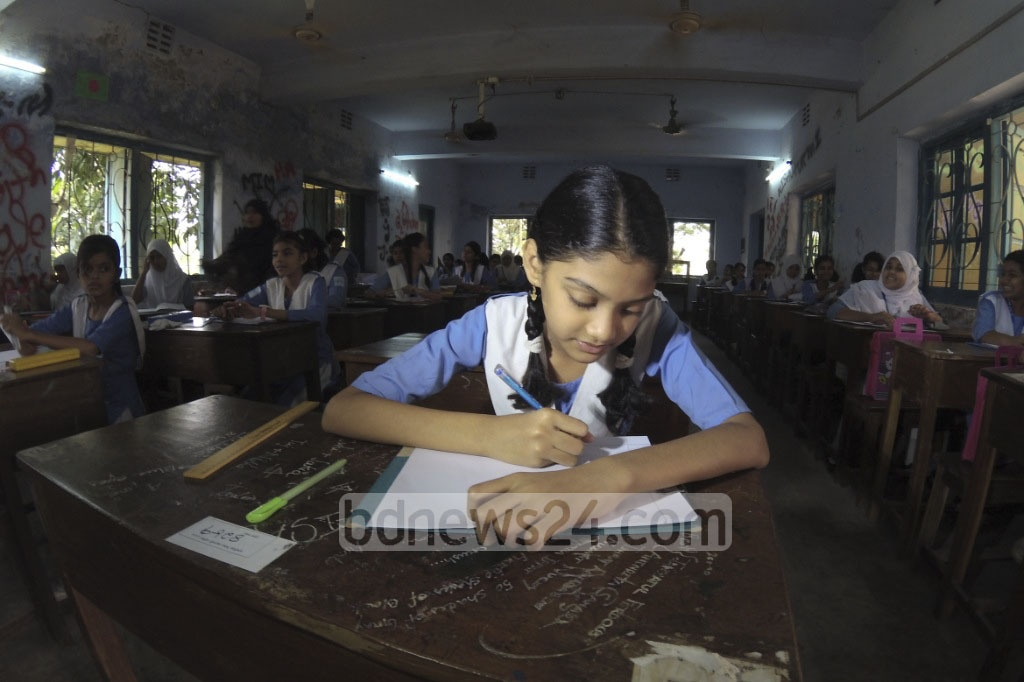 More than 3 million exam students sit for Primary Education Certificate (PEC) and equivalent tests in over 7,000 exam centres on Sunday. Photo of first day of tests at Dhaka's Argani School and College. Photo: abdul mannan
