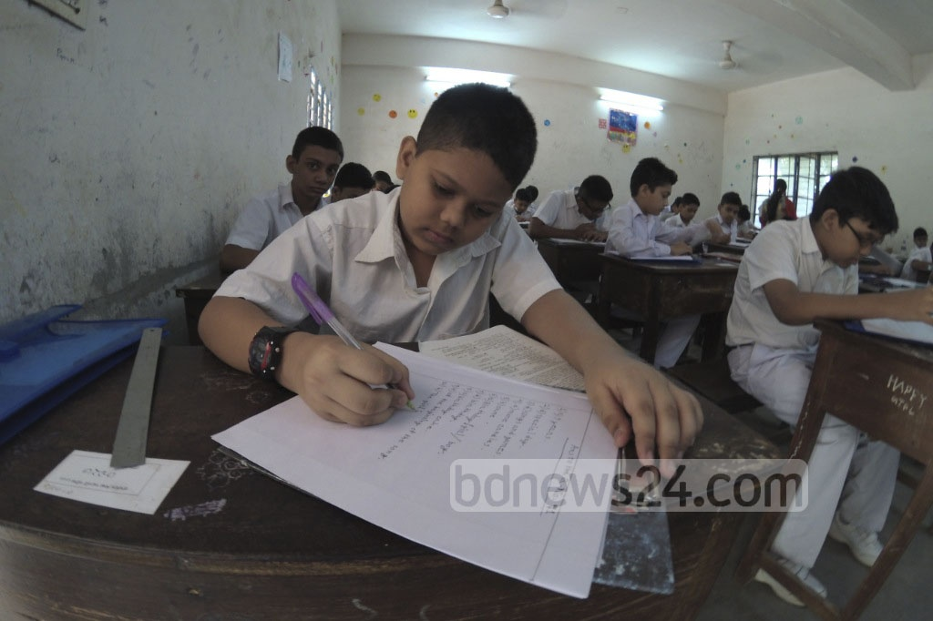 Fifth grade students take the Primary Education Certificate (PEC) examination at Dhaka's Agrani School and College on Sunday. Photo: abdul mannan