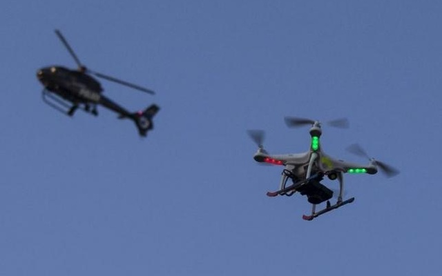 Representational Image: A police helicopter flies past a UAV drone Quadcopter which was flying over a post-march street celebration in west Baltimore, Maryland May 2, 2015. Reuters