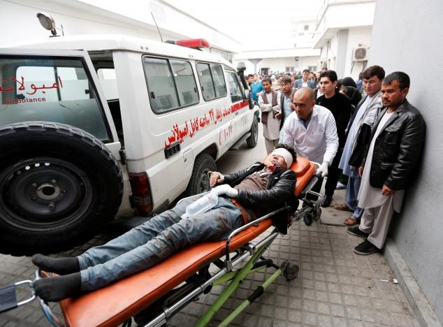 An injured man is transported to a hospital after a suicide attack in Kabul, Afghanistan November 21, 2016. reuters