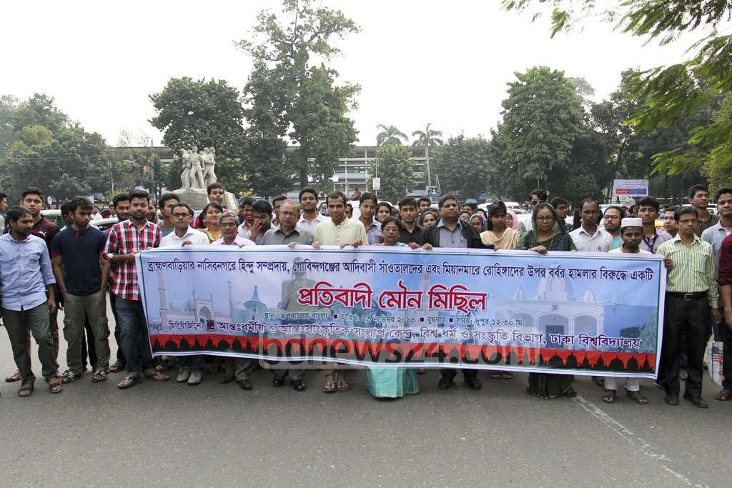A citizens' platform took out a silent procession on Wednesday on the Dhaka University campus protesting against attacks on Hindus in Brahmanbarhia, Santals in Gaibandha and Rohingyas in Myanmar. Photo: asif mahmud ove